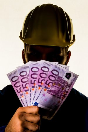 55416470 - a worker in a commercial operation with banknotes in his hand